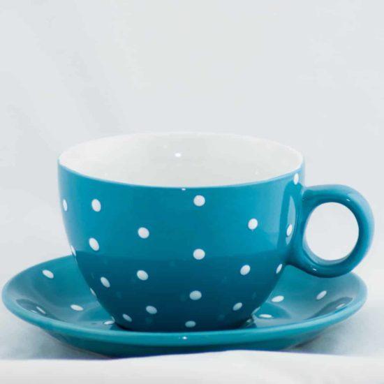 Tasse et sous tasse bleue à pois blanc d'une contenance de 33cl.